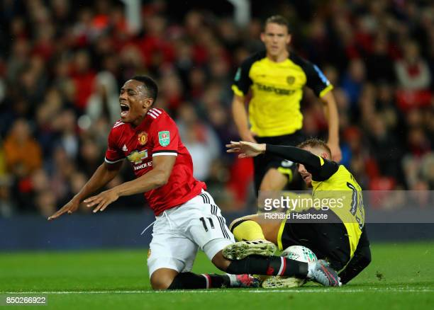 Tom Naylor of Burton Albion fouls Anthony Martial of Manchester United during the Carabao Cup Third Round match between Manchester United and Burton...