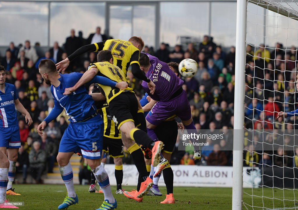 Tom Naylor of Burton Albion heads the ball past Stuart Nelson of Gillingham to score the winning goal during the Sky Bet League One match between Burton Albion and Gillingham at Pirelli Stadium on April 30, 2016 in Burton-upon-Trent, England.