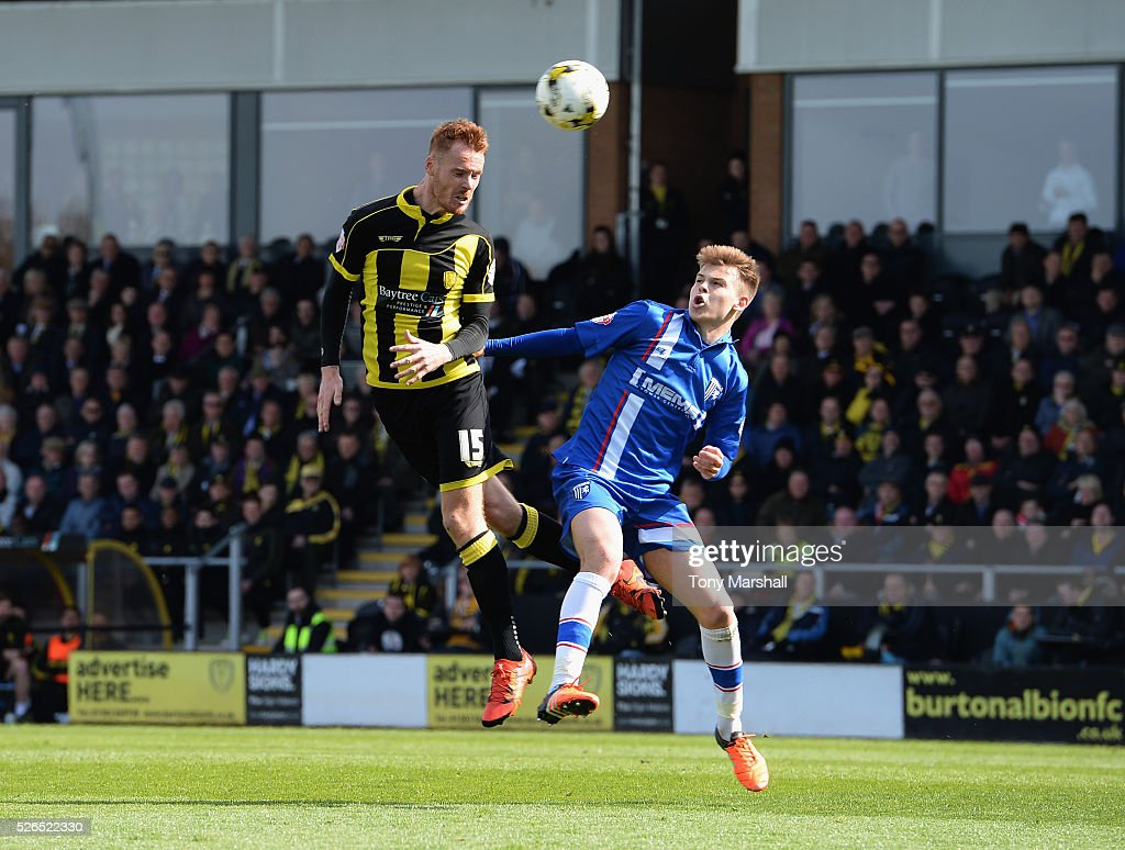 Tom Naylor of Burton Albion is challenged by Jake Hessenthaler of Gillingham during the Sky Bet League One match between Burton Albion and Gillingham at Pirelli Stadium on April 30, 2016 in Burton-upon-Trent, England.