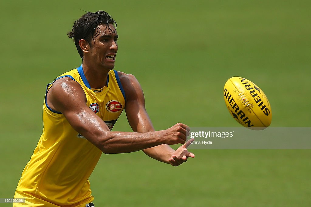 Tom Nicholls handballs during a Gold Coast Suns AFL training session at Metricon Stadium on February 20, 2013 in Gold Coast, Australia.