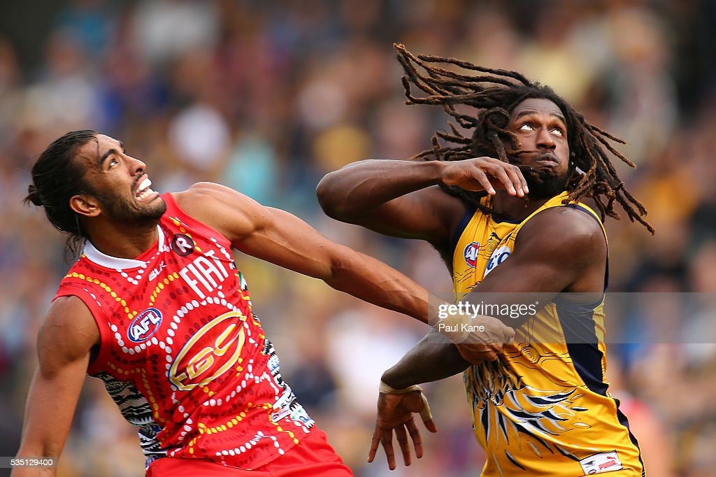 Tom Nicholls of the Suns and <a gi-track='captionPersonalityLinkClicked' href=/galleries/search?phrase=Nic+Naitanui&family=editorial&specificpeople=6577611 ng-click='$event.stopPropagation()'>Nic Naitanui</a> of the Eagles contest the ruck during the round 10 AFL match between the West Coast Eagles and the Gold Coast Suns at Domain Stadium on May 29, 2016 in Perth, Australia.