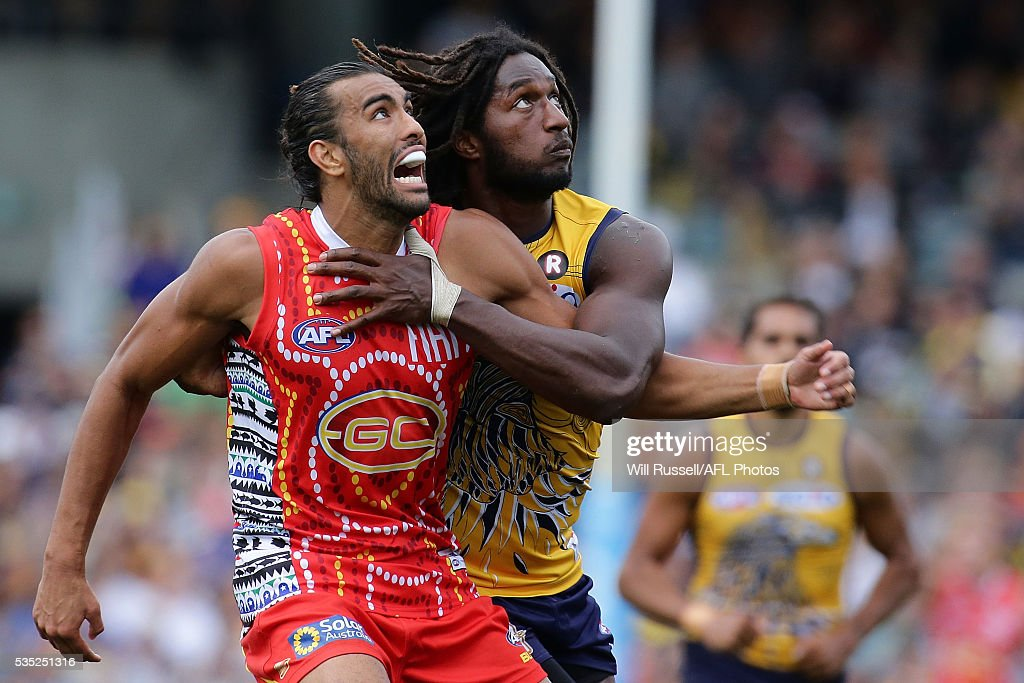 Tom Nicholls of the Suns contests a ruck with <a gi-track='captionPersonalityLinkClicked' href=/galleries/search?phrase=Nic+Naitanui&family=editorial&specificpeople=6577611 ng-click='$event.stopPropagation()'>Nic Naitanui</a> of the Eagles during the round 10 AFL match between the West Coast Eagles and the Gold Coast Suns at Domain Stadium on May 29, 2016 in Perth, Australia.