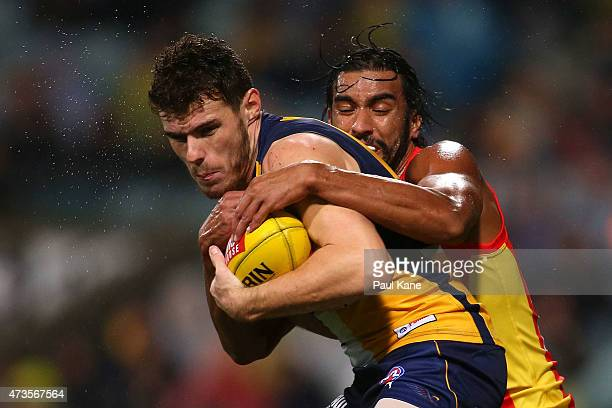 Tom Nicholls of the Suns tackles Luke Shuey of the Eagles during the round seven AFL match between the West Coast Eagles and the Gold Coast Suns at...