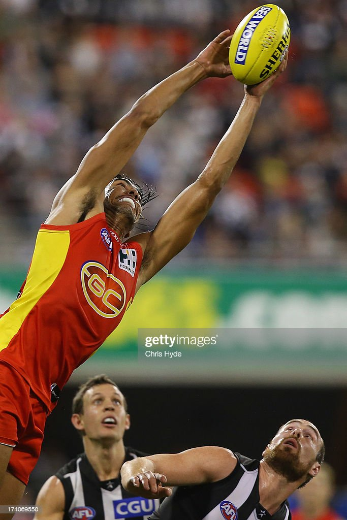 Tom Nicholls of the Suns takes a mark during the round 17 AFL match between the Gold Coast Suns and the Collingwood Magpies at Metricon Stadium on July 20, 2013 in Gold Coast, Australia.