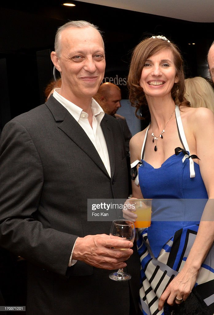 Tom Novembre and Zelia Van Den Bulke attend the 'Feerique Gallery' Zelia Van Den Bulke Exhibition At Espace Mercedes Champs Elysees on June 11, 2013 in Paris, France.