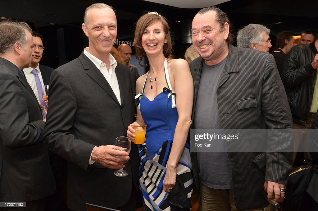 Tom Novembre, Zelia Van Den Bulke and Jean Pierre Terrasson attend the 'Feerique Gallery' Zelia Van Den Bulke Exhibition At Espace Mercedes Champs Elysees on June 11, 2013 in Paris, France.