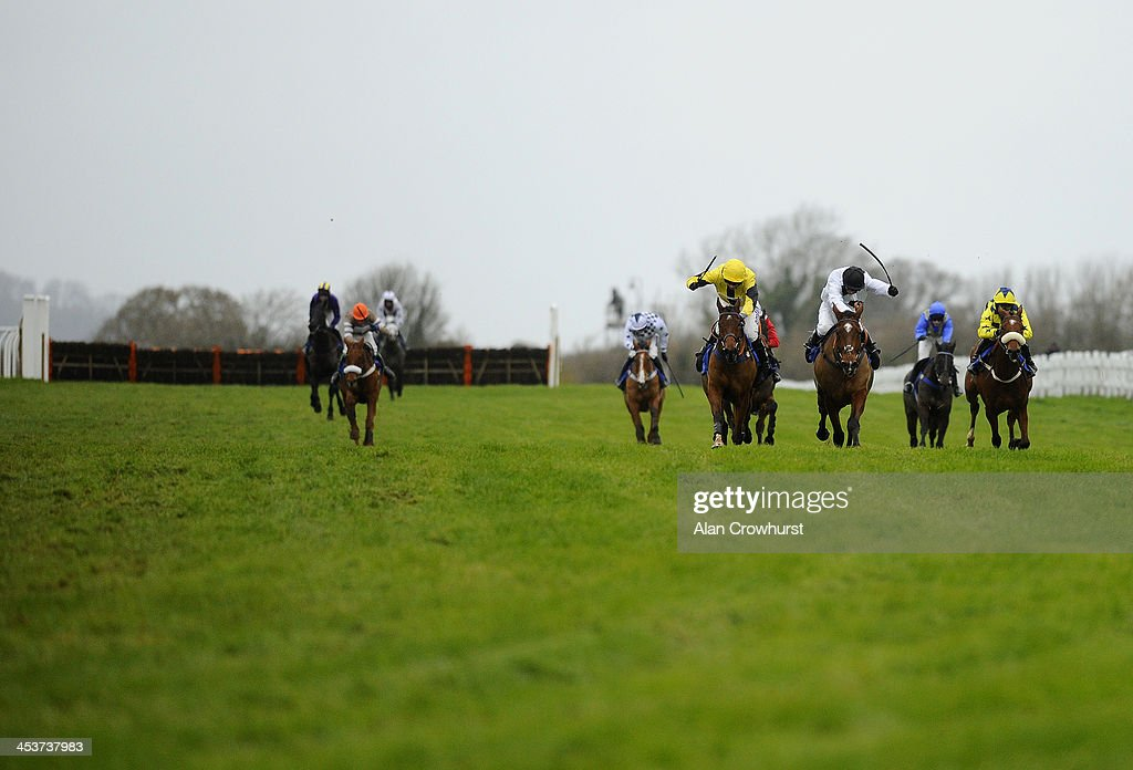 Tom O'Brien riding Rior (C, yellow) win The Yeovil Town FC 'National Hunt' Novices' Handicap Hurdle Race at Wincanton racecourse on December 05, 2013 in Wincanton, England.