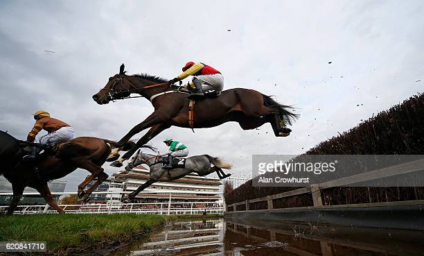 Tom O'Brien riding Sandy Beach clear the water jump before winning The bet365 Handicap Steeple Chase at Newbury Racecourse on November 3 2016 in...