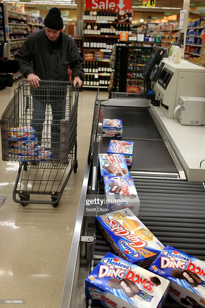 Tom O'Conner rings up his purchase of Hostess snacks at a Jewel-Osco grocery store on December 11, 2012 in Chicago, Illinois. The Jewel-Osco grocery store chain purchased the last shipment of 20,000 boxes of Hostess products and put them on sale in their stores throughout the Chicago area today. Hostess Brands Inc. shut down its baking operations and began liquidating assets last month after failing to negotiate a labor contract with Workers with the Bakery, Confectionery, Tobacco Workers and Grain Millers International Union