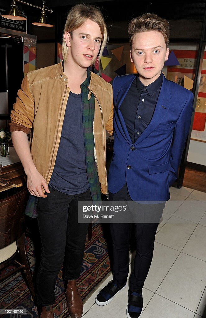 Tom Odell (L) and Conor Maynard attend as Nick Grimshaw hosts his first annual award season dinner at Hix, in association with Philips Sound, on February 19, 2013 in London, England.