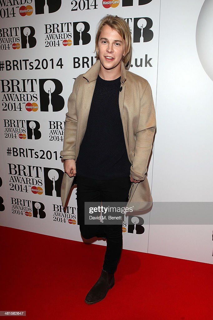 <a gi-track='captionPersonalityLinkClicked' href=/galleries/search?phrase=Tom+Odell&family=editorial&specificpeople=9163633 ng-click='$event.stopPropagation()'>Tom Odell</a> attends the BRIT Awards nominations on January 9, 2014 in London, England.