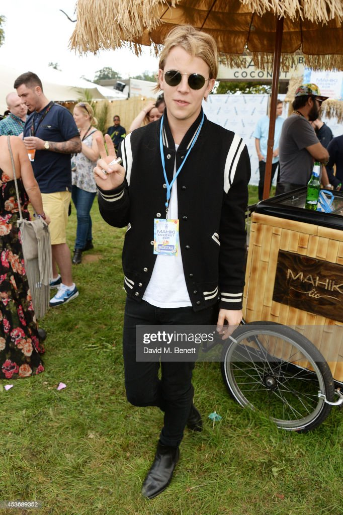 <a gi-track='captionPersonalityLinkClicked' href=/galleries/search?phrase=Tom+Odell&family=editorial&specificpeople=9163633 ng-click='$event.stopPropagation()'>Tom Odell</a> attends the Mahiki Rum Bar for the launch of the Mahiki Rum Family backstage during day 1 of the V Festival 2014 at Hylands Park on August 16, 2014 in Chelmsford, England.