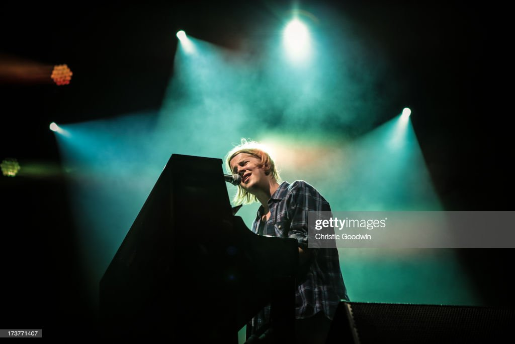 Tom Odell performs on stage as part of the annual Summer Series of openair concerts at Somerset House on July 17 2013 in London England