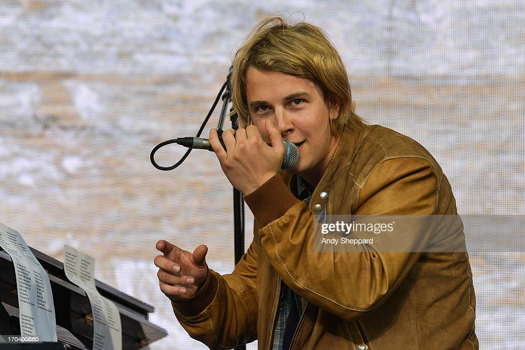 <a gi-track='captionPersonalityLinkClicked' href=/galleries/search?phrase=Tom+Odell&family=editorial&specificpeople=9163633 ng-click='$event.stopPropagation()'>Tom Odell</a> performs on stage in support of One campaign's Agit8 event at Tate Modern on June 12, 2013 in London, England.