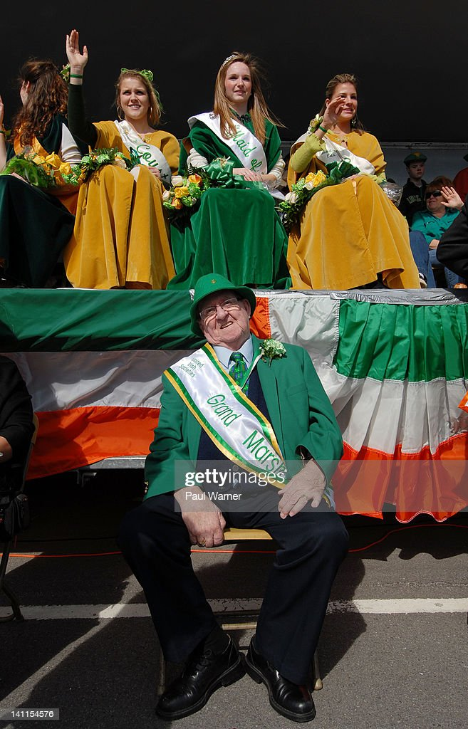Tom O'Halloran poses as Maid of Erin, Maggie Donnelly (C) and her court, Marie Kathleen Schwartz (L) and Caitlin Cox (R) attend the St. Patrick's Day Parade on the streets of Detroit on March 11, 2012 in Detroit, Michigan.