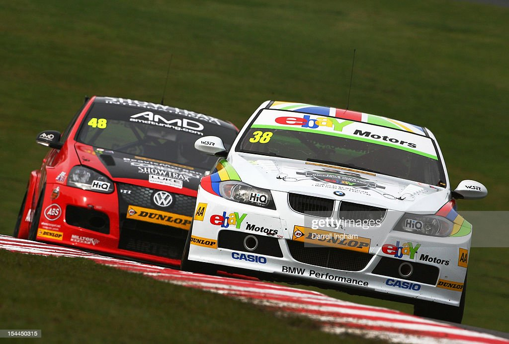 Tom Onslow-Cole of Great Britain drives the #38 eBay Motors BMW 320si ahead of Ollie Jackson in the #48 AmD Tuning VW Golf during practice for the Dunlop MSA British Touring Car Championship race at the Brands Hatch Circuit on October 20, 2012 near Longfield, United Kingdom.