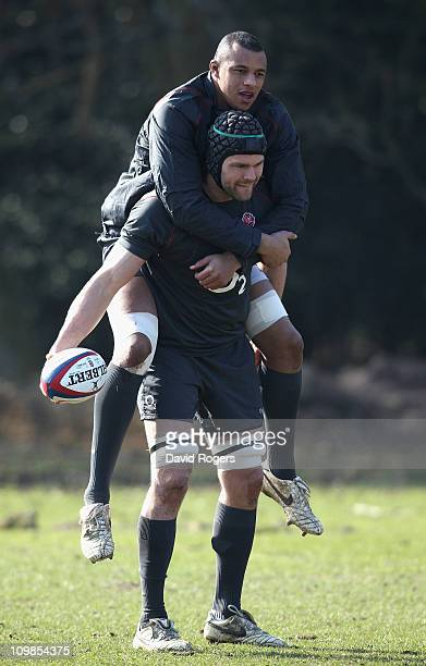 Tom Palmer lifts team mate Courtney Lawes during the England training session held at the Pennyhill Park Hotel on March 8 2011 in Bagshot England