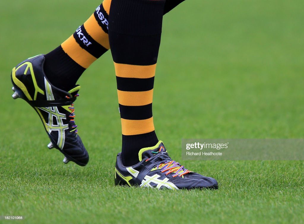 Tom Palmer of Wasps wears the rainbow laces of The Stonewall initiative, a campaign against homophobic discrimination in sport during the Aviva Premiership match between London Wasps and Worcester Warriors at Adams Park on September 28, 2013 in High Wycombe, England.