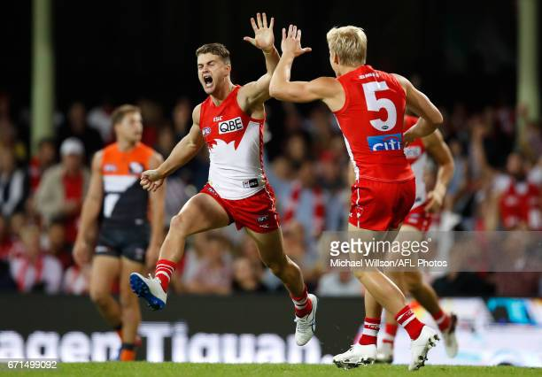 Tom Papley and Isaac Heeney of the Swans of the Swans celebrate a goal during the 2017 AFL round 05 match between the Sydney Swans and the GWS Giants...