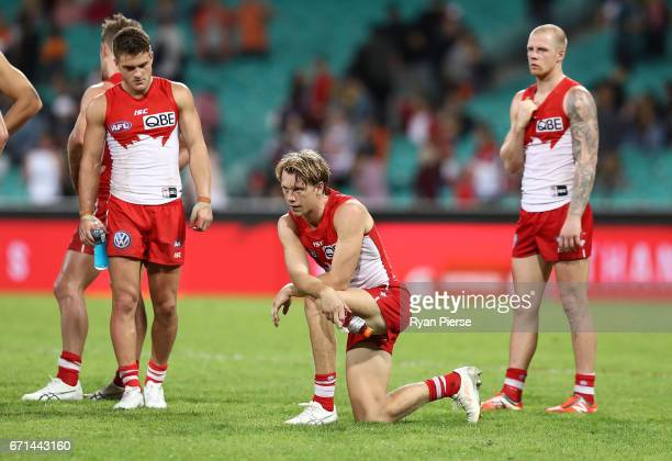 Tom Papley Callum Mills and Zak Jones of the Swans looks dejected after the round five AFL match between the Sydney Swans and the Greater Western...