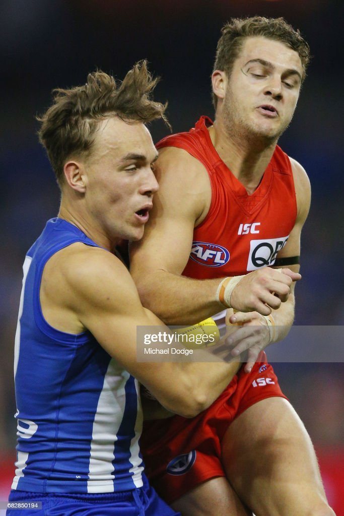 Tom Papley of the Swans collides into Ryan Clarke of the Kangaroos during the round eight AFL match between the North Melbourne Kangaroos and the Sydney Swans at Etihad Stadium on May 14, 2017 in Melbourne, Australia.
