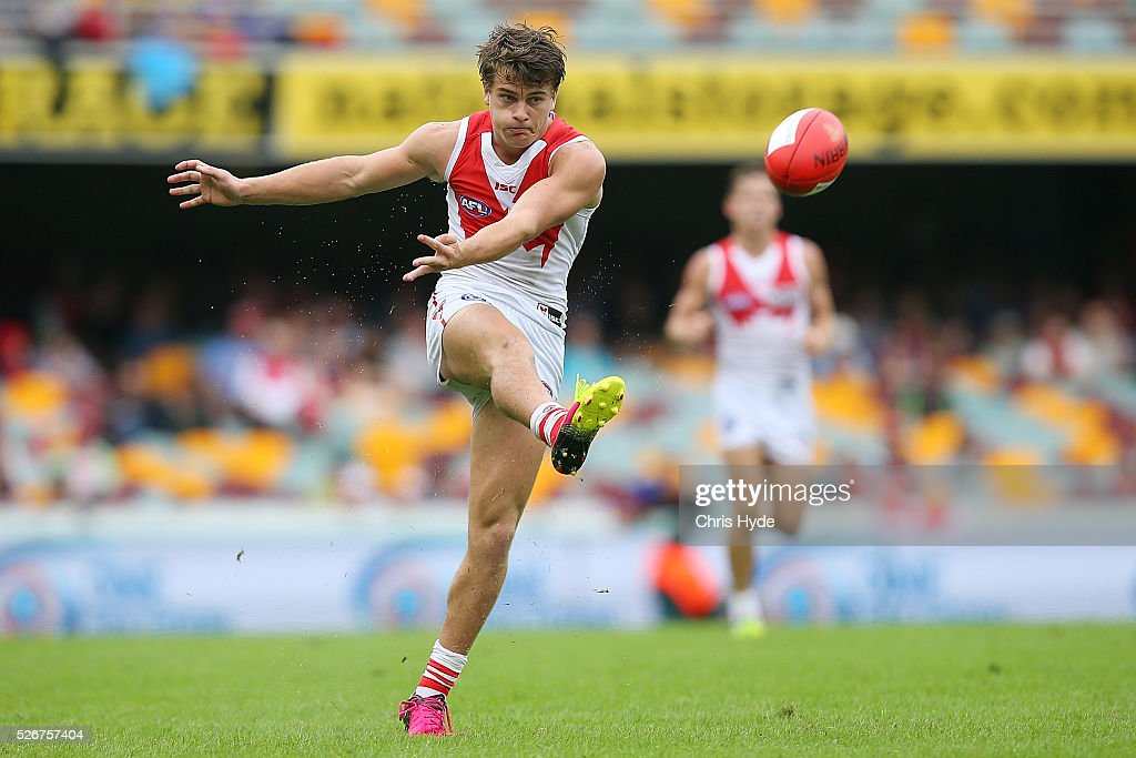 Tom Papley of the Swans kicks during the round six AFL match between the Brisbane Lions and the Sydney Swans at The Gabba on May 1, 2016 in Brisbane, Australia.