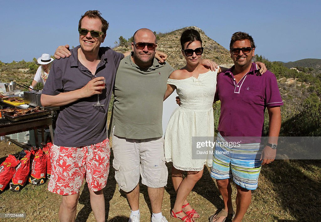 Tom Parker Bowles (L) and <a gi-track='captionPersonalityLinkClicked' href=/galleries/search?phrase=Gizzi+Erskine&family=editorial&specificpeople=5536167 ng-click='$event.stopPropagation()'>Gizzi Erskine</a> (2R) pose with guests at the Teenage Cancer Trust pool party hosted by Jaime Winstone at the Groucho Club Gpop-up on August 22, 2013 in Ibiza, Spain.