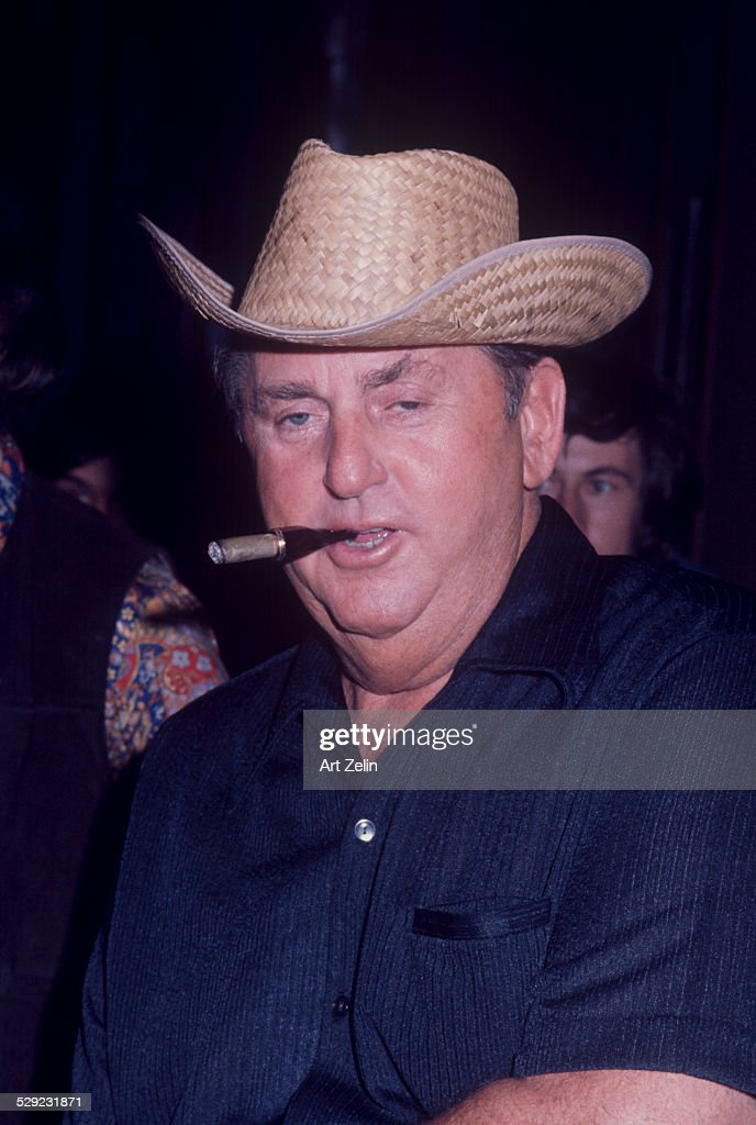 Tom Parker Elvis Presley's manager wearing a straw hat and smoking a cigar circa 1970 New York