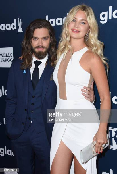 Tom Payne and Jennifer Akerman attend the 28th annual GLAAD Media awards at the Beverly Hilton hotel in Beverly Hills California April 1 2017 / AFP...