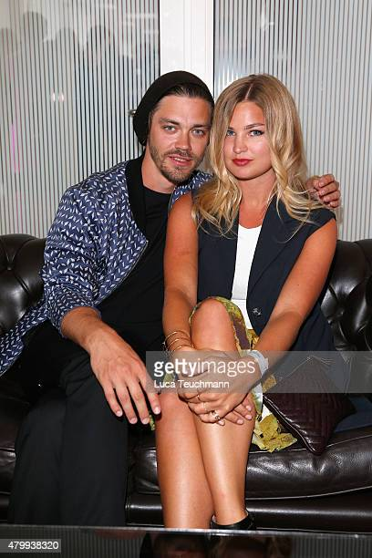 Tom Payne and Jennifer Akerman attend the Kilian Kerner show during the MercedesBenz Fashion Week Berlin Spring/Summer 2016 at on July 8 2015 in...