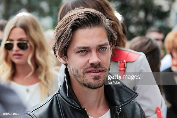Tom Payne attends Der Berliner Modesalon on July 10 2015 in Berlin Germany