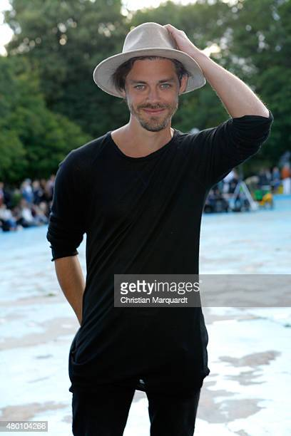 Tom Payne attends the Perret Schaad show during the MercedesBenz Fashion Week Berlin Spring/Summer 2016 at on July 9 2015 in Berlin Germany