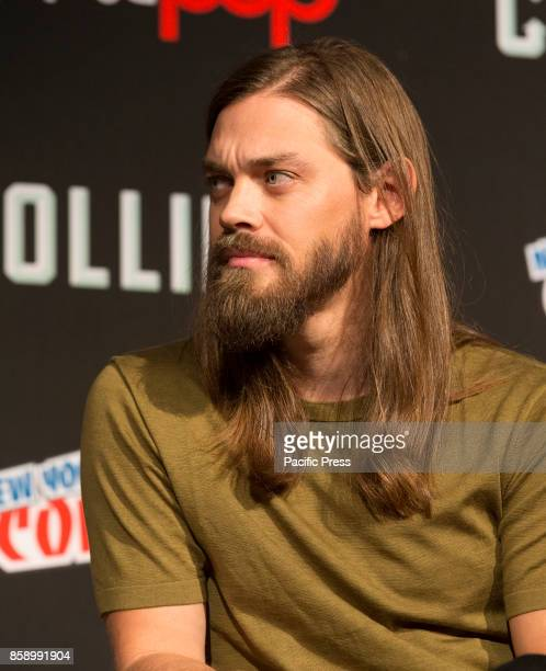 Tom Payne attends The Walking Dead panel at The Theater at Madison Square Garden during Comic Con 2017