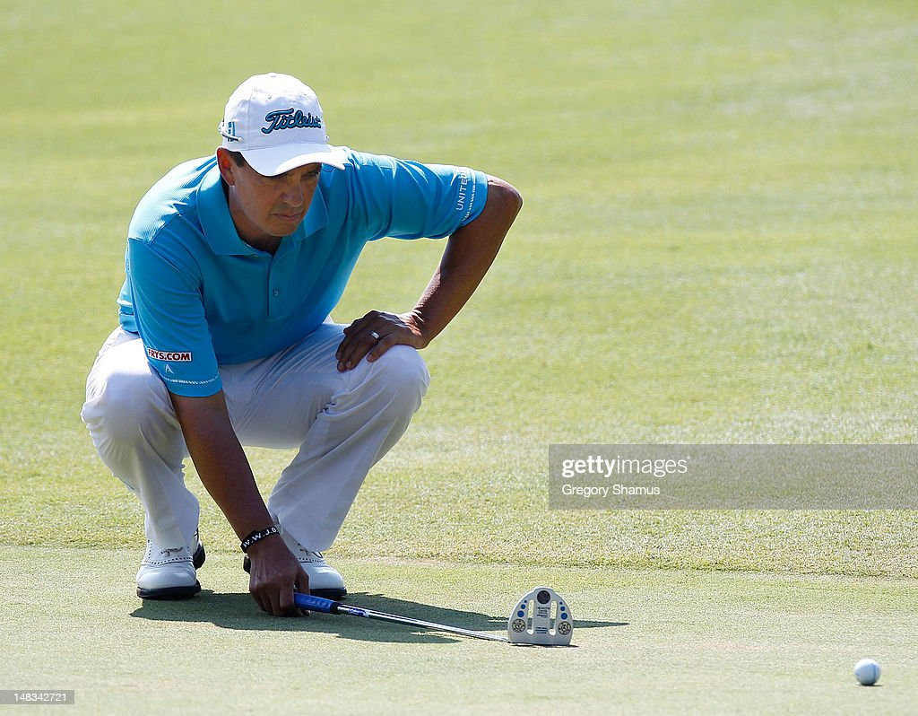 <a gi-track='captionPersonalityLinkClicked' href=/galleries/search?phrase=Tom+Pernice+Jr.&family=editorial&specificpeople=562466 ng-click='$event.stopPropagation()'>Tom Pernice Jr.</a> lines up a putt on the 18th green during the third round of the 2012 Senior United States Open at Indianwood Golf and Country Club on July 14, 2012 in Lake Orion, Michigan.