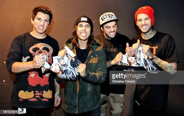 Tom Perry Vic Fuentes Mike Fuentes and Jaime Preciado of Pierce The Veil pose after meeting fans and signing copies of a new HMV Exclusive TShirt at...