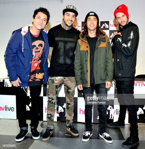 Tom Perry Vic Fuentes Mike Fuentes and Jaime Preciado of Pierce The Veil pose before meeting fans and signing copies of a new HMV Exclusive TShirt at...