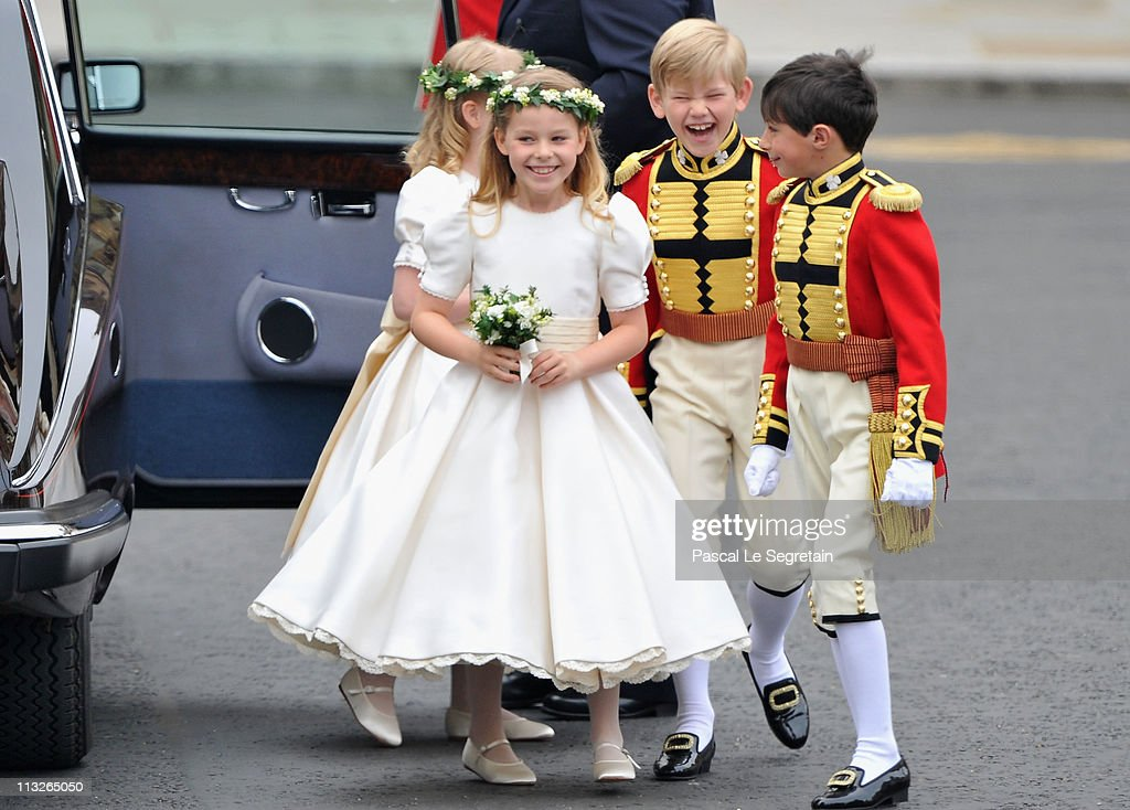 Tom Pettifer laughs as he arrives with Master William LowtherPinkerton Lady Louise Windsor and Margarita ArmstrongJones to attend the Royal Wedding...