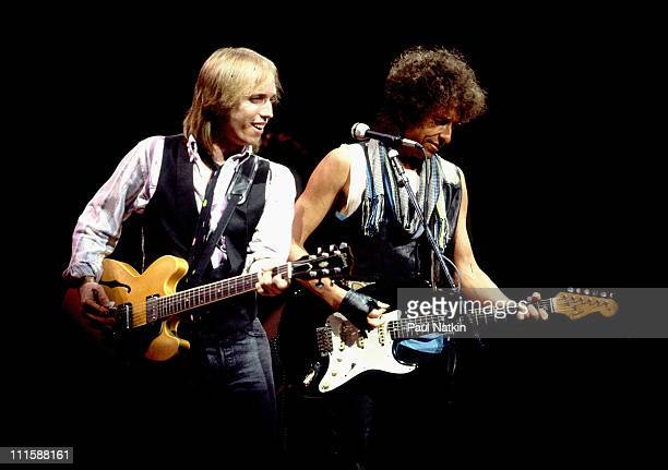 Tom Petty and Bob Dylan during Bob Dylan and Tom Petty in Concert July 22 1986 at Poplar Creek Music Theater in Chicago Illinois United States