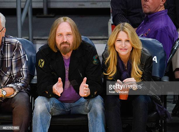 Tom Petty and Dana York attend a basketball game between the Houston Rockets and the Los Angeles Lakers at Staples Center on January 25 2015 in Los...
