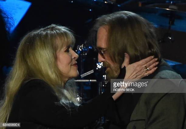 Tom Petty and Stevie Nicks perform during the 2017 MusiCares Person of the Year honouring Tom Petty in Los Angeles California on February 10 2017 /...