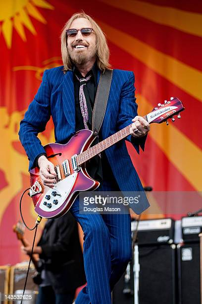 Tom Petty and the Heartbreakers perform during the 2012 New Orleans Jazz Heritage Festival at the Fair Grounds Race Course on April 28 2012 in New...