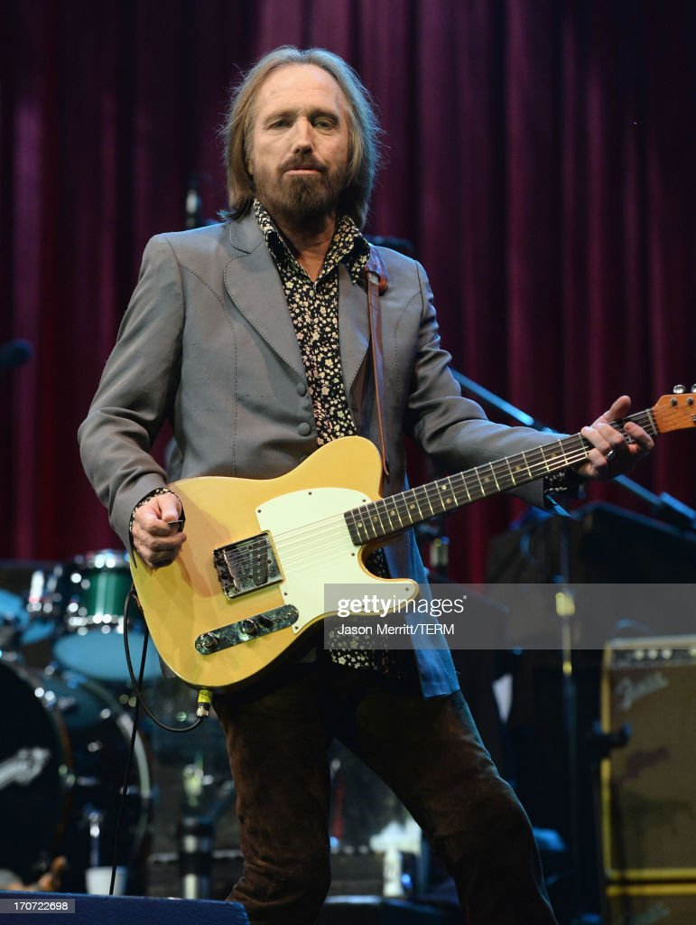 Tom Petty and the Heartbreakers perform onstage during day 4 of the 2013 Bonnaroo Music & Arts Festival on June 16, 2013 in Manchester, Tennessee.