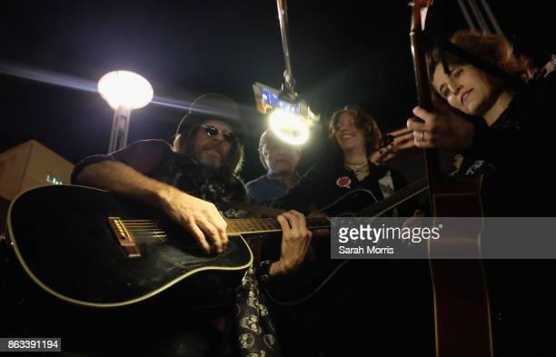 Tom Petty impersonator performs during the Tom Petty Memorial Vampire Walk down Ventura Blvd on October 19 2017 in Sherman Oaks California