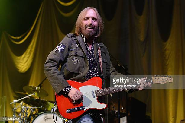 Tom Petty of Tom Petty and the Heartbreakers performs on stage at United Center on August 23 2014 in Chicago United States