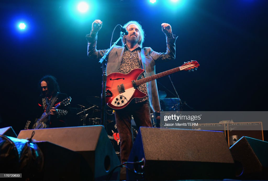 <a gi-track='captionPersonalityLinkClicked' href=/galleries/search?phrase=Tom+Petty&family=editorial&specificpeople=224789 ng-click='$event.stopPropagation()'>Tom Petty</a> of <a gi-track='captionPersonalityLinkClicked' href=/galleries/search?phrase=Tom+Petty&family=editorial&specificpeople=224789 ng-click='$event.stopPropagation()'>Tom Petty</a> and the Heartbreakers performs onstage at What Stage during day 4 of the 2013 Bonnaroo Music & Arts Festival on June 16, 2013 in Manchester, Tennessee.