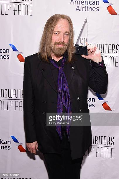 Tom Petty poses with award during Songwriters Hall Of Fame 47th Annual Induction And Awards at Marriott Marquis Hotel on June 9 2016 in New York City