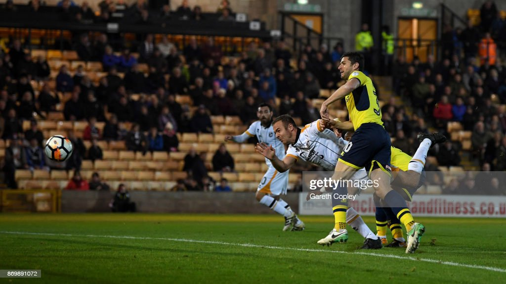 Tom Pope of Port Vale scores his team's second goal during The Emirates FA Cup First Round match between Port Vale and Oxford United at Vale Park on November 3, 2017 in Burslem, England.