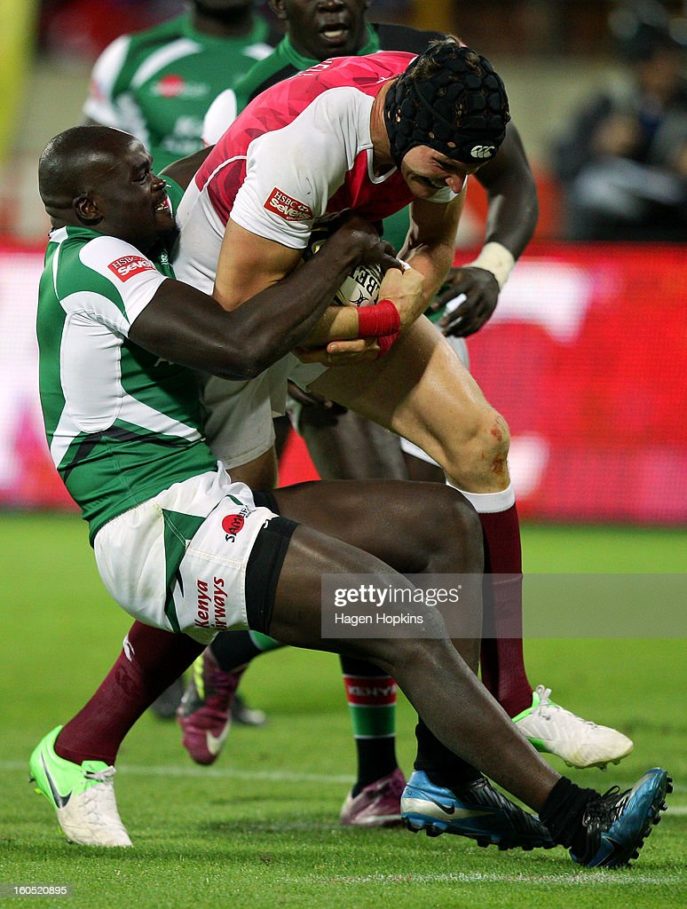 Tom Powell of England is tackled by Horace Otieno of Kenya in the final cup match between England and Kenya during the 2013 Wellington Sevens at Westpac Stadium on February 2, 2013 in Wellington, New Zealand.
