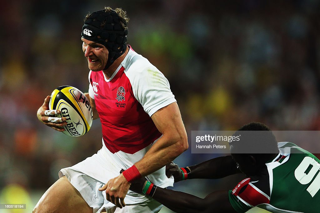 Tom Powell of England makes a break during the grand final between England and Kenya during the 2013 Wellington Sevens at Westpac Stadium on February 2, 2013 in Wellington, New Zealand.