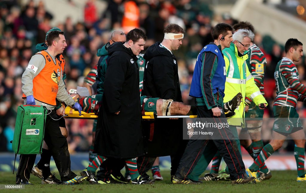 <a gi-track='captionPersonalityLinkClicked' href=/galleries/search?phrase=Tom+Price&family=editorial&specificpeople=653710 ng-click='$event.stopPropagation()'>Tom Price</a> of Leicester Tigers is stretchered off during the LV=Cup match between Leicetser Tigers and London Wasps at Welford Road on January 26, 2013 in Leicester, England.